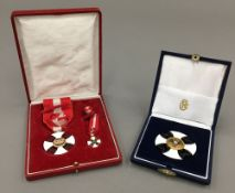 Two cased Continental enamel medals