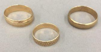 Three 9 ct gold wedding bands (10 grammes)
