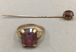 A 9 ct gold stone set ring and a stick pin (3.