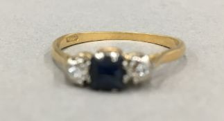 An 18 ct gold diamond and sapphire ring (2.