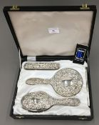 A cased silver dressing table set