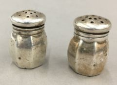 A pair of silver peppers