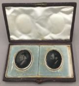 A cased pair of Victorian photographic portrait miniatures