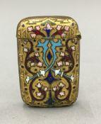 An enamel decorated vesta case