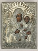 A white metal clad painted icon