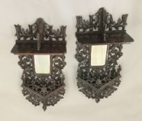 A pair of 19th century Black Forest carved wall mirrors