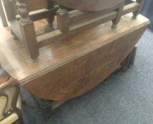 A large 18th/19th century oak gate leg table