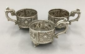 Three Chinese silver cup holders