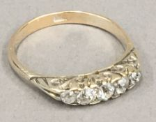 An 18 ct gold five stone diamond ring (2.