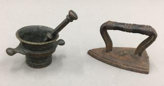 A miniature bronze pestle and mortar,