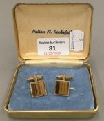 A pair of 9 ct gold tiger's eye cufflinks (10 grammes total weight)