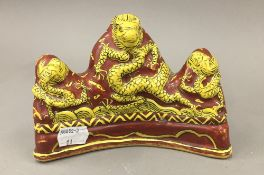 A Chinese dragon form brush rest