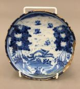 A small 19th century Delft pottery dish