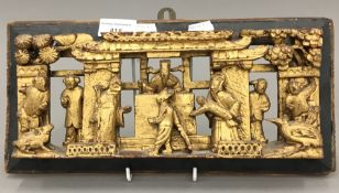 A Chinese, circa 1900, carved gilt wood panel worked with a scene from a Magistrates Court,