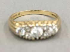 A 14 K gold ring (3.