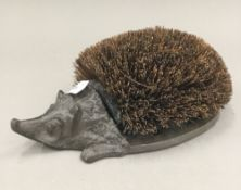 A hedgehog boot brush