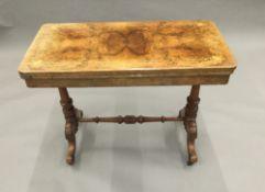 A Victorian inlaid walnut card table