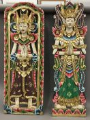 A pair of Eastern painted carved wooden figural hangings and canopies, etc.