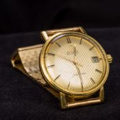 An Omega 18 ct gold cased automatic Seamaster wristwatch The signed champagne dial with baton hour