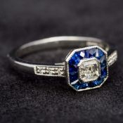 A platinum diamond and sapphire ring Of chamfered square section form,