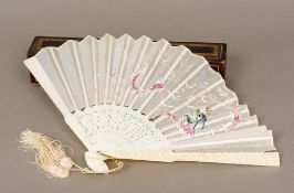A 19th century Chinese canton carved ivory and embroidery fan The blade embroidered with a dragon