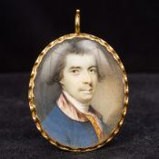 A Georgian unmarked gold framed portrait miniature Painted with a male bust,