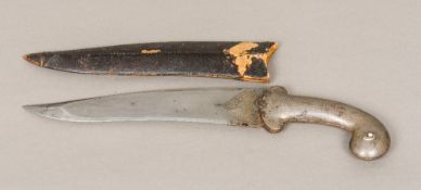 A 19th century Indo-Persian dagger (Khanjar) The scrolling handle with white metal inlaid
