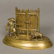 A 19th century bronze desk letter stand Formed as a rabbit with a shotgun hunting a boar.