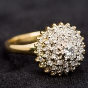 An 18 ct gold and diamond cluster ring Of domed stepped form. 1.2 cm high.