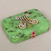 A Russian unmarked gold diamond and enamel set spinach jade box Of hinged rounded rectangular form,