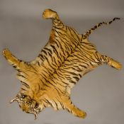 An early 20th century tiger (panthera tigris) skin taxidermy rug With flat head.