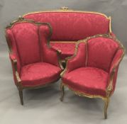 A matched 19th century carved giltwood framed upholstered three piece suite,