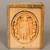 A 19th century Greek carved wooden panel Of oval form, centrally carved with a saint,
