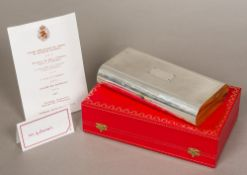 A Cartier unmarked silver clad wooden box Of hinged domed rectangular form,