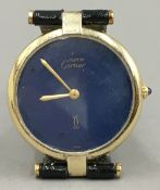 A Cartier mid-sized 18 ct gold Vermeil wristwatch The blue dial inscribed Must de Cartier.