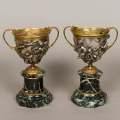 A pair of 19th century silvered and gilt bronze classical urns Each of twin handled form,
