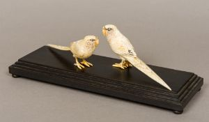 Two 19th century Japanese carved ivory models of parakeets Each naturalistically modelled and set