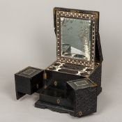 A 19th century ebonised Indian carved travelling work/dressing box Profusely carved with scrolling