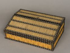 A 19th century Anglo-Indian quill mounted ivory and ebony writing slope Of hinged form,