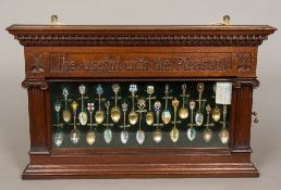 A Victorian/Edwardian carved walnut wall mounted display cabinet Carved with crossed spoons and the
