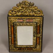 A 19th century Dutch repousse gilt metal mounted and tortoiseshell wall glass The bevelled