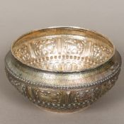 A Tibetan silver bowl Embossed in the round with dogs-of-fo,