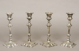 A set of four Victorian silver plated candlesticks Each removable drip-pan above the double knopped