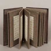 A Chinese folding book set with jade panels The covers with carved calligraphy. 22.5 cm high.