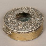 A 19th century Tibetan silver and copper Buddhist travelling shrine Of circular form,