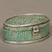 A small early 19th century unmarked silver mounted shagreen box Of hinged oval form. 6 cm wide.