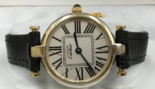 A lady's 18 ct gold Vermeil wristwatch by Cartier With Cartier deployment strap. 2.75 cm wide.