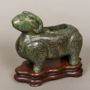 A large Chinese carved jade model of a ram Decorated in the round with various scrolling and