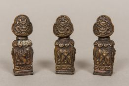 Three Tibetan bronze seals Each worked with mythical beasts, each with cast matrix. Each 7 cm high.