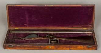 A Victorian double barrelled side by side percussion shotgun,